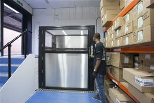 Stannah Levelmaster low-rise platform goods lift – solving stock flow in a split-level storeroom