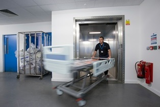 Stannah 2000kg goods passenger lift – supporting King's College Hospital with a goods-accompanied lift solution